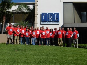 The CBE team celebrates the L.A. Clippers new logo with t-shirts in front of CBE's headquarters.