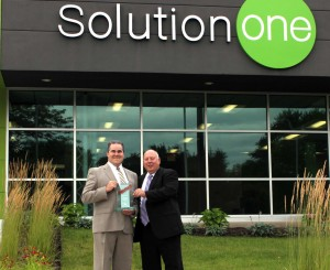 VP of Technology Services, Cody Webster and Service Manager, Chris Logston, holding SolutionOne's 2015 Konica Minolta Pro Tech Service Center Award. This is the 11th consecutive year SolutionOne has won the award, and we are the only local dealer to be Pro Tech Certified.