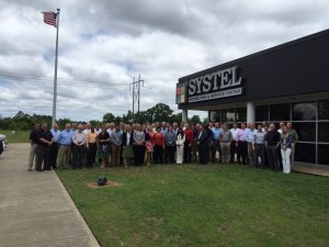 President/CEO Keith Allison with Systel's sales professionals companywide at its new 125,00 square foot Distribution and Service Center in Fayetteville, NC.