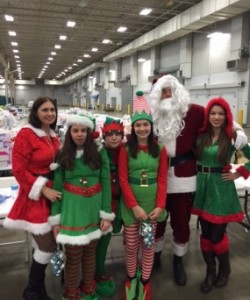 Santa (Chris Zvirbulis) and his helpers (the Zvirbulis family) are ready to spread the holiday cheer at the Santa Comes to Town holiday party.